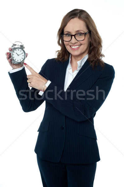 Corporate executive pointing towards the clock Stock photo © stockyimages