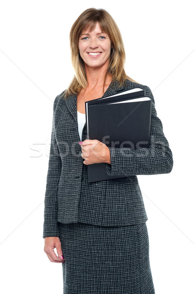 Happy businesswoman ready to attend meeting Stock photo © stockyimages