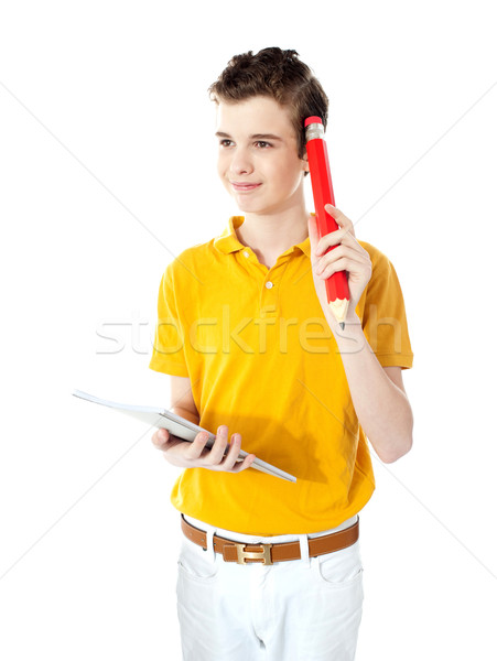 School boy trying to recall answer Stock photo © stockyimages