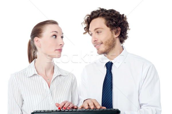 Young secretaries typing in keyboard Stock photo © stockyimages