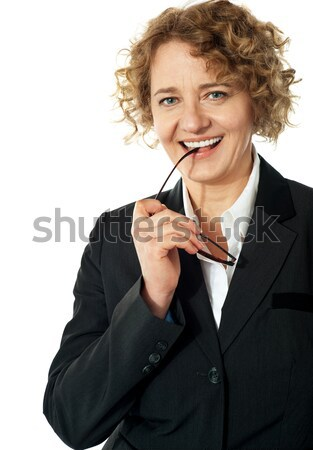 Curly haired corporate woman posing with ipad Stock photo © stockyimages