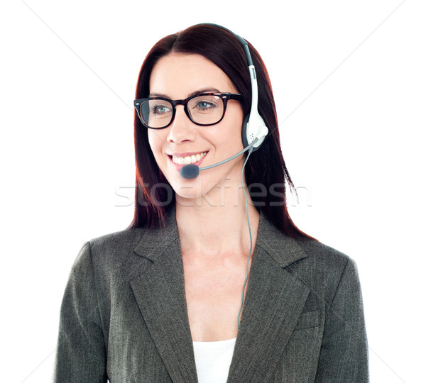 Cheerful female customer care operator looking away Stock photo © stockyimages