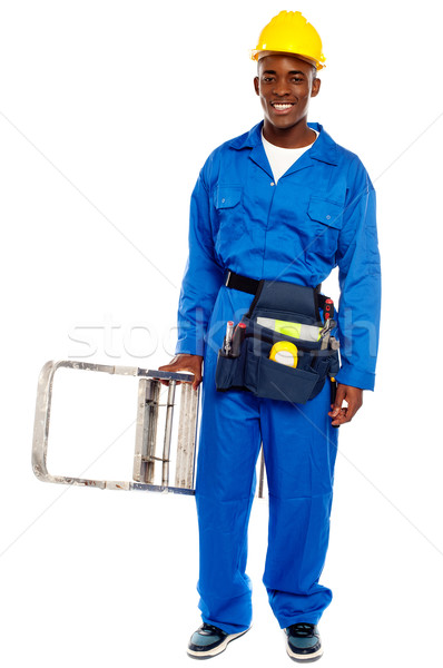 African repairman holding stepladder Stock photo © stockyimages