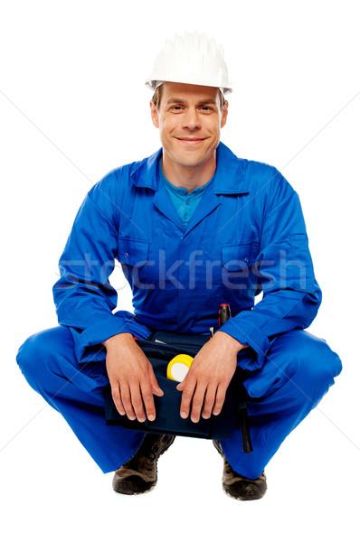 Zâmbitor masculin lucrător siguranţă pălărie Imagine de stoc © stockyimages
