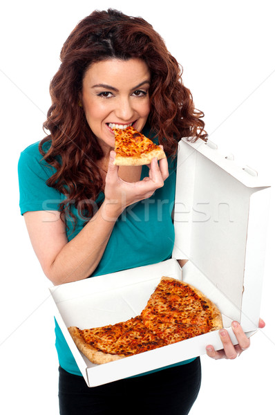 Jeunes fille pizza seuls Photo stock © stockyimages
