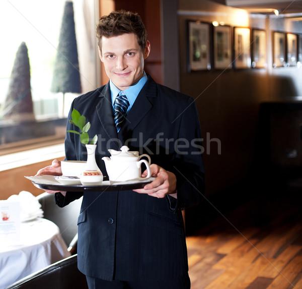 Tea idő jól kinéző házigazda étterem tart Stock fotó © stockyimages