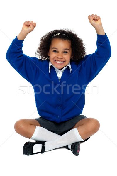 Escola primária menina dentes excitação sessão piso Foto stock © stockyimages