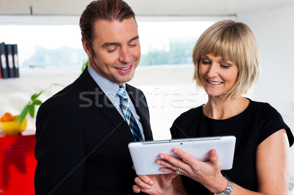 Female secretary showing appointments to boss saved on tablet device Stock photo © stockyimages