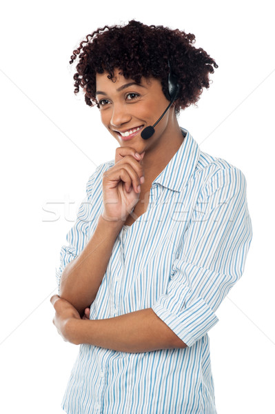 Shy customer support executive looking away Stock photo © stockyimages