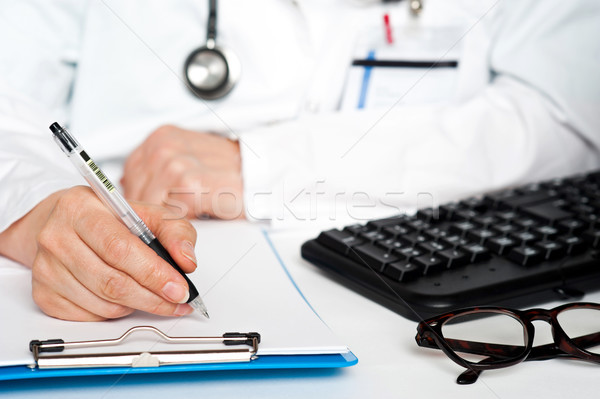 Cropped image of a physician writing prescription Stock photo © stockyimages