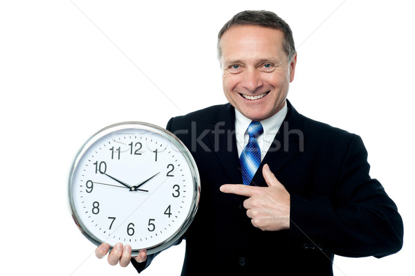 Clock is in business man hands Stock photo © stockyimages