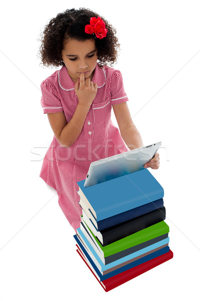 Unsure school kid using tablet pc Stock photo © stockyimages