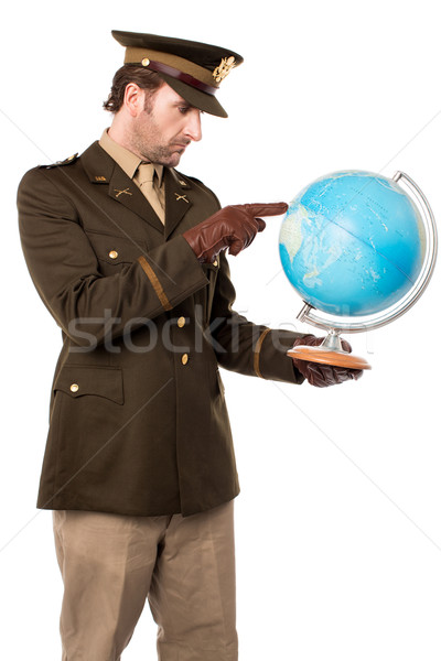 Military officer pointing the globe Stock photo © stockyimages
