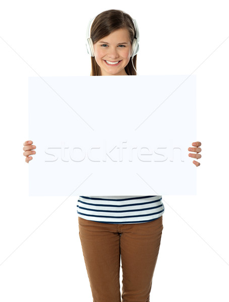 Musical girl promoting blank banner ad Stock photo © stockyimages