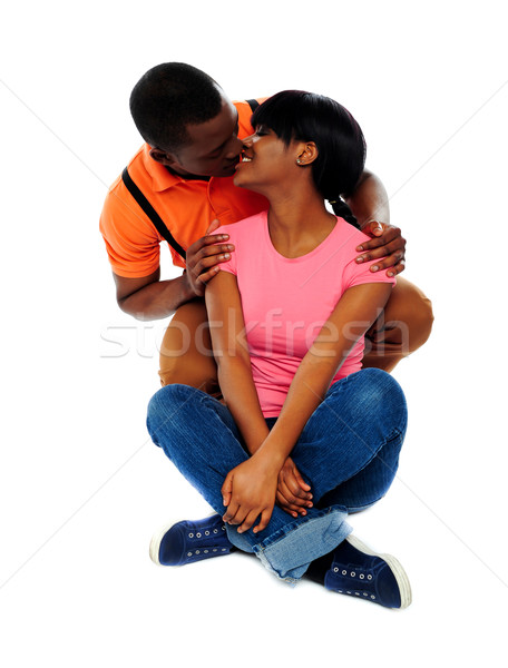 Smiling young couple about to kiss Stock photo © stockyimages