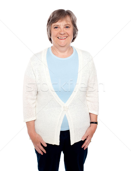 Attractive cheerful casual senior woman Stock photo © stockyimages