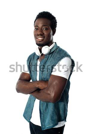 Man standing with headphones around his neck Stock photo © stockyimages