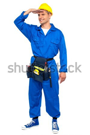 Repairman looking forward shielding hand Stock photo © stockyimages