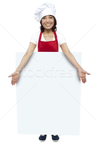 Full length portrait of young chef presenting billboard Stock photo © stockyimages