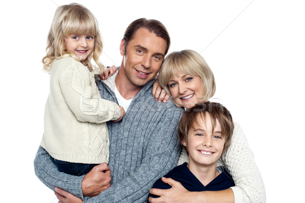 Retrato de família casal dois crianças isolado branco Foto stock © stockyimages