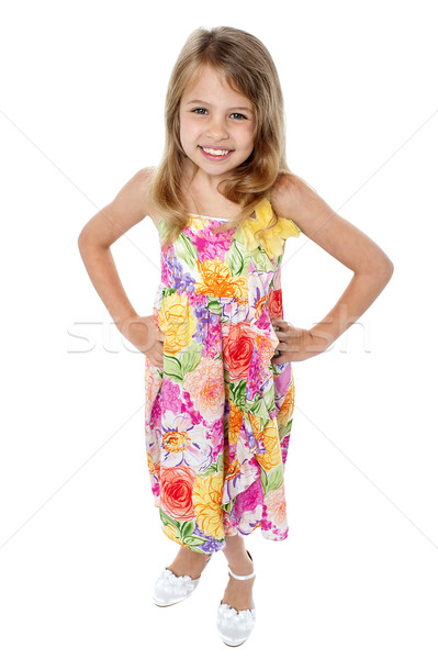 Aerial shot of trendy young girl in sleeveless frock Stock photo © stockyimages