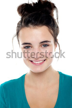 Smiling cute young girl facing camera Stock photo © stockyimages