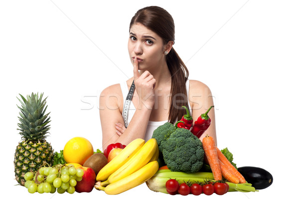 Mischievous look of a young woman with fruits Stock photo © stockyimages