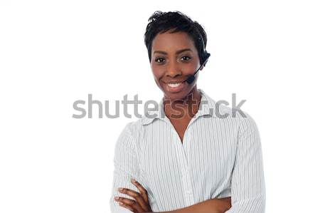Attractive female call centre executive Stock photo © stockyimages