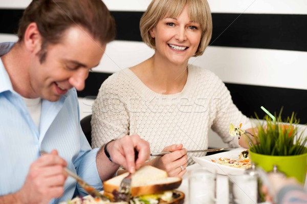 Couple enjoying breakfast in restaurant Stock photo © stockyimages