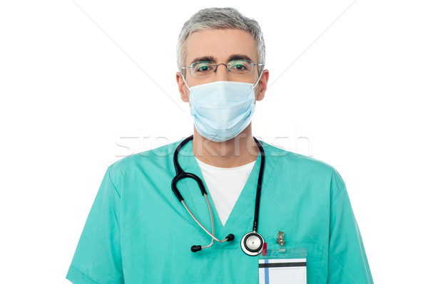 Male doctor with face mask Stock photo © stockyimages