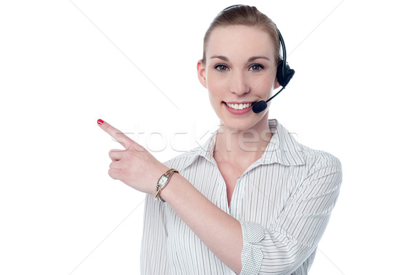 Female call center executive wearing headset  Stock photo © stockyimages