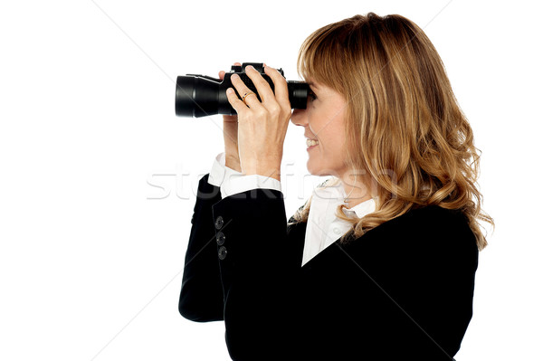 Attractive woman viewing through binocular Stock photo © stockyimages