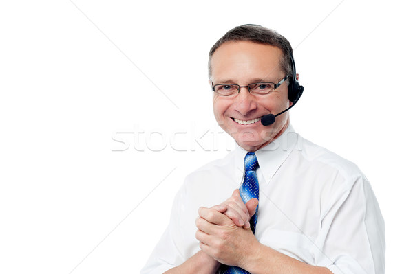 Smiling customer support executive Stock photo © stockyimages