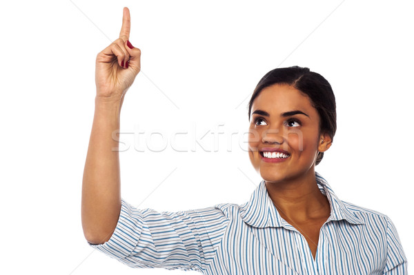 Corporate woman pointing upwards Stock photo © stockyimages
