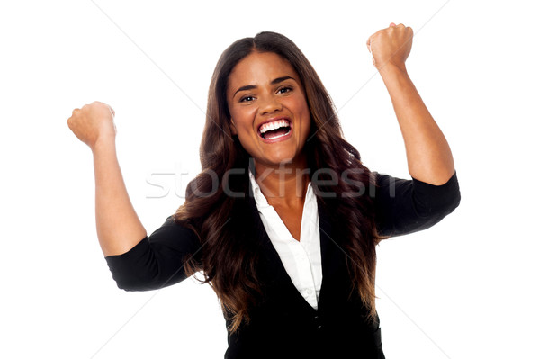 Excited woman with clenched fists Stock photo © stockyimages