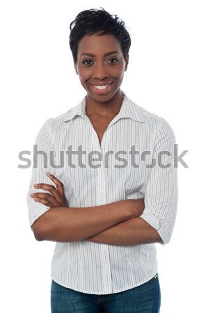 Woman in casuals, arms crossed Stock photo © stockyimages