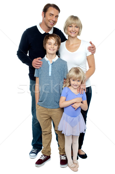Indoor studio shot of lovely family, four members Stock photo © stockyimages
