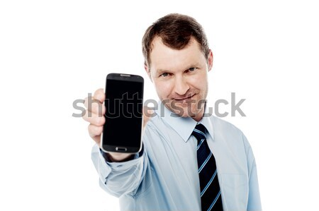 Salesman displaying newly launched mobile Stock photo © stockyimages