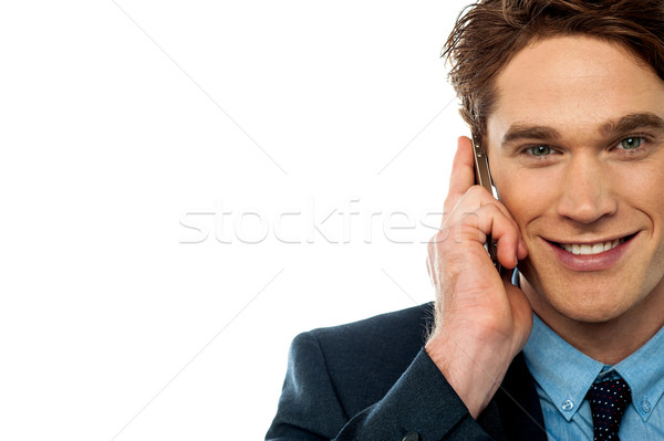 Businessman attending an important call Stock photo © stockyimages