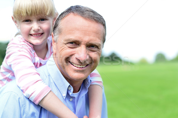 Happy father and daughter at outdoors Stock photo © stockyimages