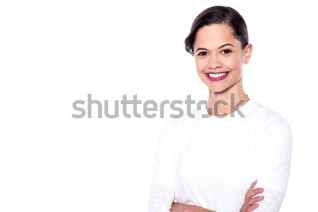 Pretty woman posing casually Stock photo © stockyimages