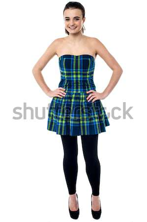 Attractive young girl with hands on waist Stock photo © stockyimages