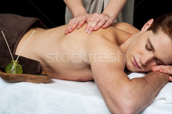 Lying man getting a back massage  Stock photo © stockyimages