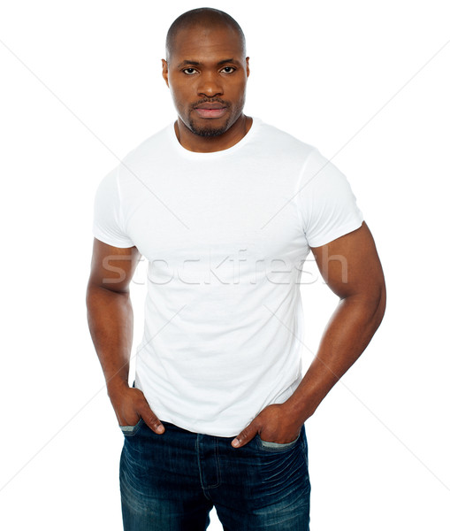 Trendy muscular guy posing in style Stock photo © stockyimages