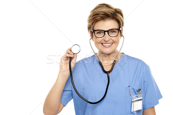 Senior female physician ready to examine you Stock photo © stockyimages
