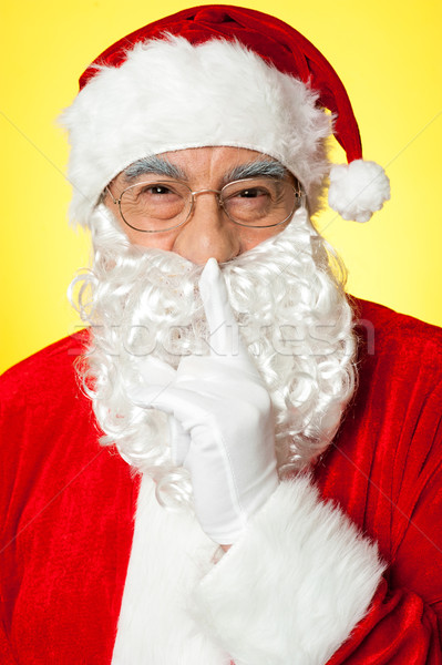 Shh...Aged Santa gesturing silence Stock photo © stockyimages