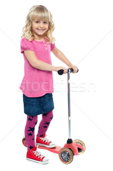 ストックフォト: 女の子 · おもちゃ · スクーター · 見える · カメラ