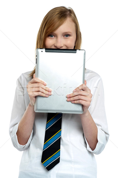 Timide fille cacher visage comprimé appareil Photo stock © stockyimages