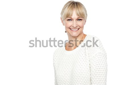 Stock photo: Smiling middle aged woman in trendy wear
