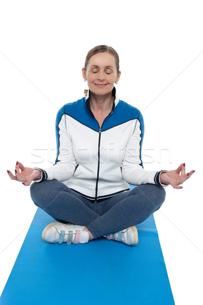 Portrait of a woman sitting in a lotus position Stock photo © stockyimages